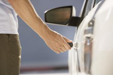 Man unlocking car door