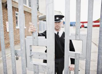 Security guard closing gate