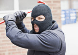 Burglar in ski mask wielding crowbar