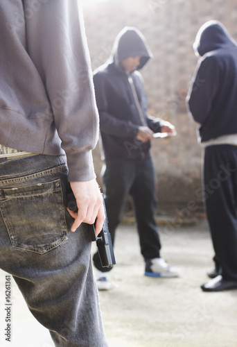 Man with gun approaching drug dealers