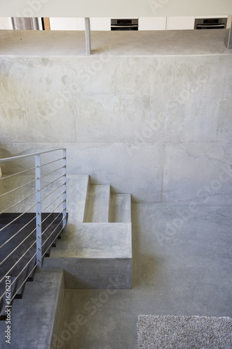 """Interior of modern house, metal staircase"""