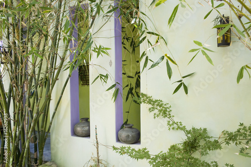 Green wall with bamboo and window openings