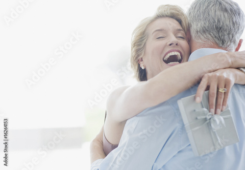 Man giving wife anniversary gift