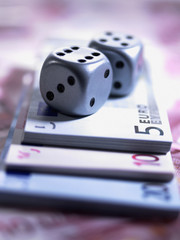 Close up of dice and euro notes