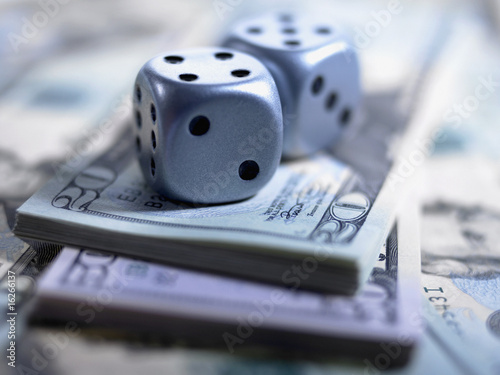 Close up of dice and US currency