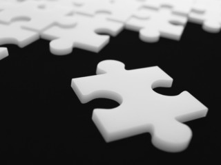 Close up of single puzzle piece near others