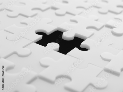 Interlocking puzzle pieces with one piece missing