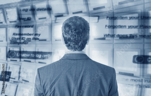 Businessman with computer screen in background
