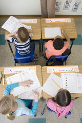 Students doing school work in classroom