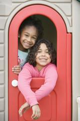 Girls inside playhouse