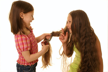 Girls playing a hairdressing salon