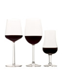 Three glasses of red wine isolated on white background