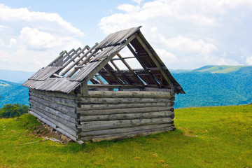 old wooden house in mountains