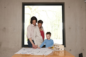 family with house model