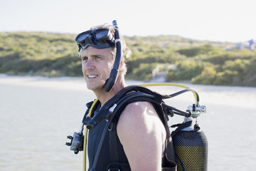 Man in scuba gear on beach