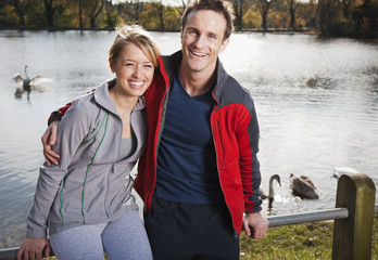 Couple smiling near pond