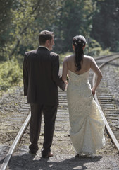 Bride and groom on railway tracks