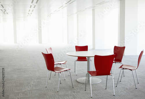 Table and chairs in empty office