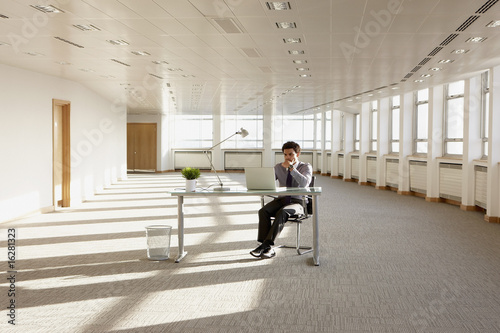 Businessman working in empty office