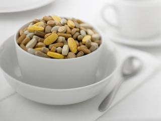Close up of bowl full of vitamins