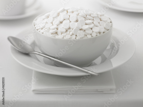 Close up of bowl full of medicine tablets