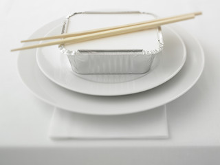 Close up of container of asian food on plate