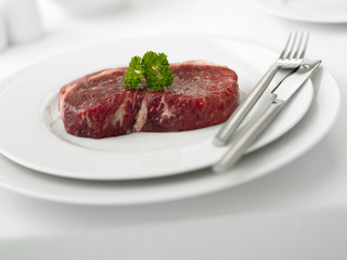 Close up of raw beef on plate