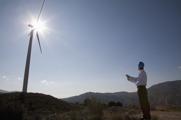 Businessman looking at wind turbine