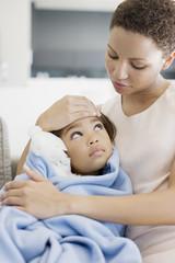 Woman hugging sick daughter