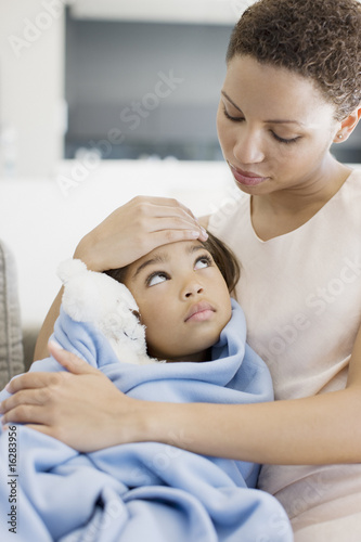 Woman hugging sick daughter