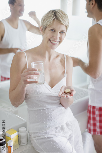 Woman taking vitamins in the morning