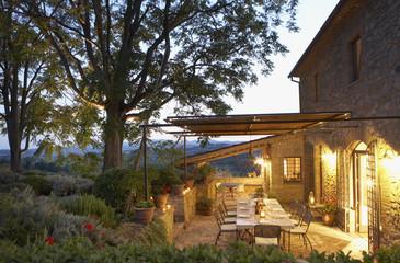 """Elegant table set on patio, Umbria, Italy"""