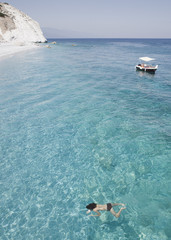 """Girl swimming in ocean near beach, Lalaria Beach, Skiathos, Greece"""