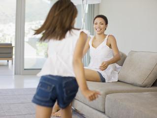 Girl running towards mother