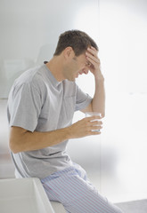 Man with headache drinking water