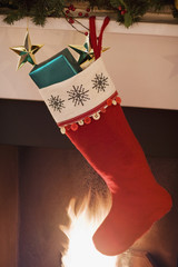 Christmas stocking hanging on fireplace mantel