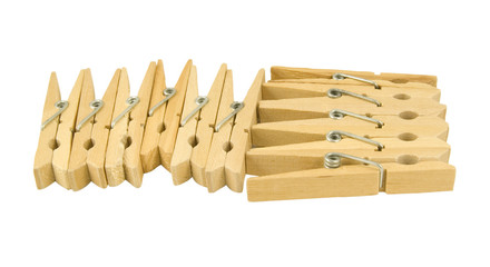 selection of wooden clothes pegs isolated on white background