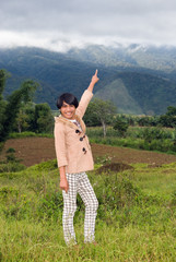 Young tourist guide in tropical mountains