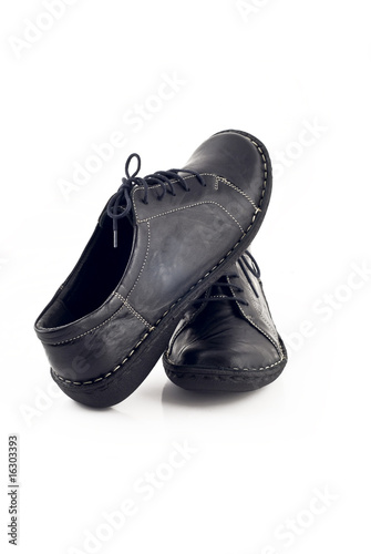 Pair of black leather shoes for women over white