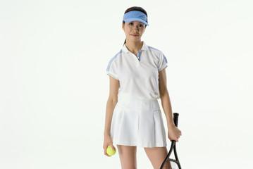 テニスをする女性