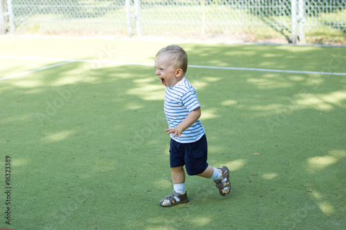 Boy  running on stadium