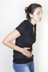 Young woman with stomachache isolated on white background