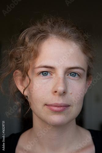 Leinwanddruck Bild junge blonde Frau als Portrait