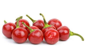 Some round red hot peppers