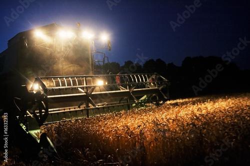 Leinwandbild Motiv Combine Harvester in the Cornfield 07
