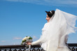 bride with bouquet at parapet