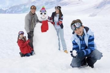 Family making snowman
