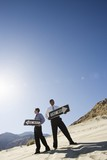 Two Businessmen Holding One Way Signs in the Desert