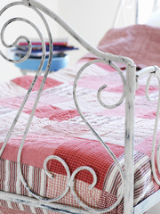 Bed covered with patchwork quilt