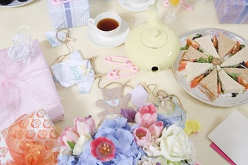 Food and Flowers on a Table at a Baby Shower